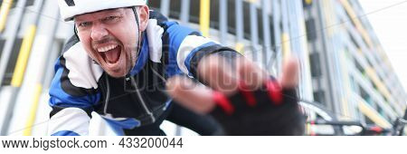 Cyclist In Helmet Falling Off His Bike And Screaming