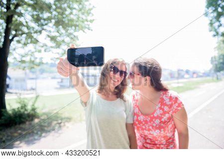 Girlfriends Taking Selfie Together Having Fun Outdoors Concept Of Modern Women Friendship Lifestyle