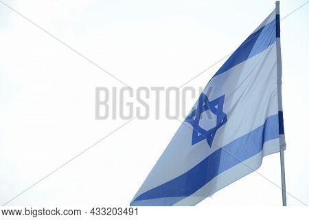 Israeli Flag Weaving In The Wind Against Bright Skies