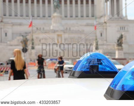 Blue Sirens Of Police  Car And The Monument Called Altare Della Patria In Background In Rome