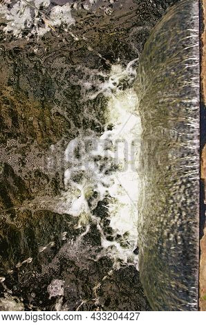 Waterfall Abstraction. Abstract View Of Falling Water. Small Waterfall In The City.