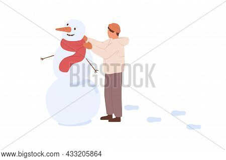 Child Making Snowman With Carrot And Twigs, Putting Scarf On Hime. Kid Playing Outdoors On Winter Ho