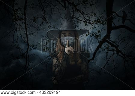 Halloween Witch Wearing Medical Face Mask Showing Silence Sign With Finger Over Lips Standing Over D