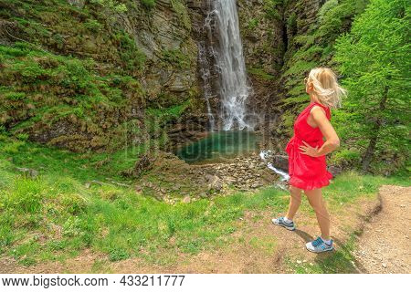 Woman Looking The Froda Waterfall Or Sonogno Waterfall Over The Riale Carded River In Sonogno Town O