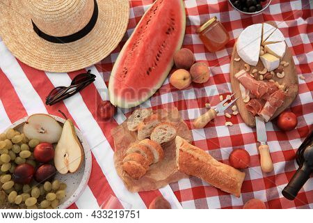 Different Tasty Snacks On Picnic Blanket, Flat Lay