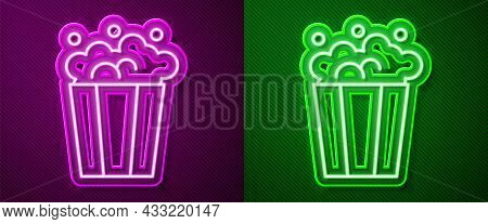 Glowing Neon Line Popcorn In Cardboard Box Icon Isolated On Purple And Green Background. Popcorn Buc