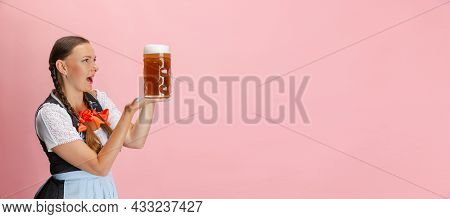 Flyer With Adorable Oktoberfest Woman, Waitress Wearing A Traditional Bavarian Or German Dirndl Hold