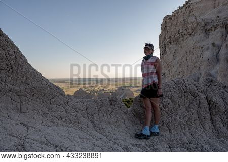 Woman Poses At Badlands Overlook At The End Of The Notch Trail