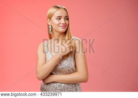 Confident Tender Carefree Charming Blond Girl Party In Silver Shiny Glamour Dress Pointing Looking R