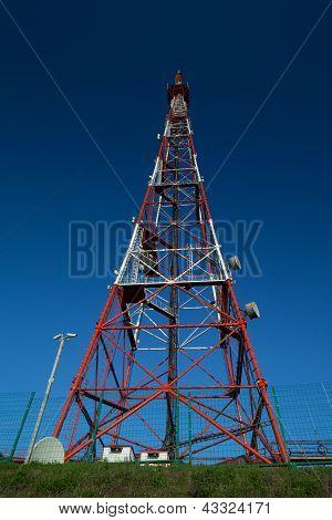 Telecom broadcasting tower under blue sky