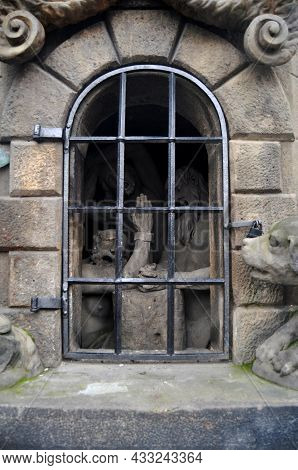 Cultural Monument And Ancient Ruin Antique Stone Statue On Charles Bridge Crossing Vltava Moldau Riv