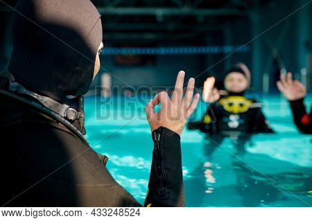Instructor and two divers, course in diving school