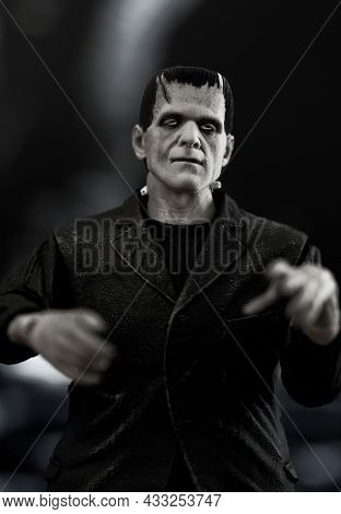 SEPT 15, 2021: Frankenstein monster lurking in a castle dungeon - NECA Ultimate black and white figure