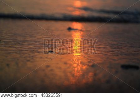 Sunset Of The Red Sun In The Sea, Reflection Of The Setting Sun In The Sea Water, Clouds In The Ligh