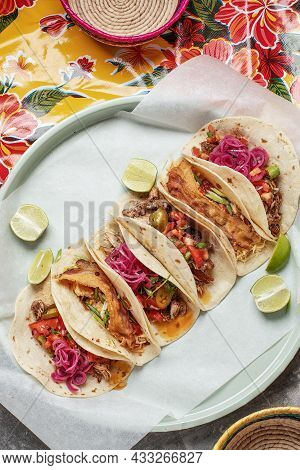 Mixed Mexican Tacos With Homemade Salsa, Limes And Parsley On Bright Traditional Background