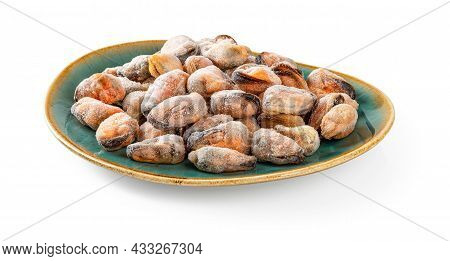 Frozen Peeled Mussels On An Oval Turquoise Ceramic Plate Isolated On A White Background. Iced Mussel