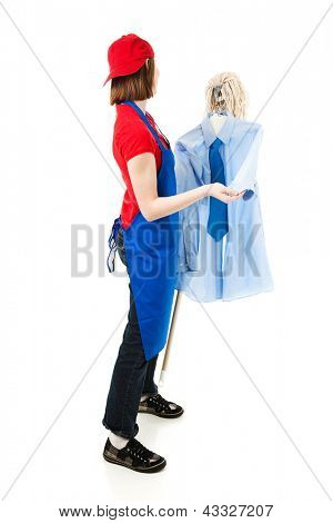 Teenage worker holding a mop with a shirt and tie and pretending to dance with them.  Isolated on white.