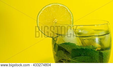 Cool Summer Fresh. Drink With Mint In A Glass, A Slice Of Lime In A Glass With A Drink. Alcoholic Dr
