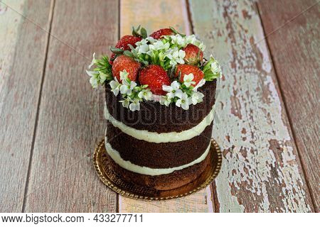 Naked Chocolate Cake, Filled With Coconut Brigadeiro. Decorated With Strawberries And White Kalancho