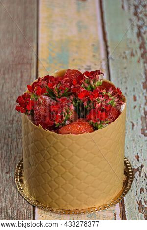 Dress Cake, Wrapped In A Textured Layer Of Salted Caramel Chocolate, With Strawberries And Red Kalan