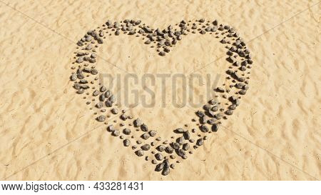 Concept or conceptual stones on beach sand handmade symbol shape, golden sandy background, like icon. 3d illustration metaphor for love, popular, trendy, health, romance and marriage