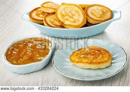 Small Homemade Pancakes In Blue Oval Plate, Lemon Jam In Bowl, Pancake With Lemon Jam In Blue Saucer