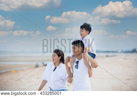 Active Parents And People Outdoor Activity On Summer Vacations And Holiday With Children.happy Asian