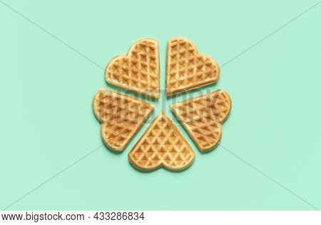 Above View With Heart-shaped Isolated On A Green Mint Background. Homemade Belgian Waffles Arranged