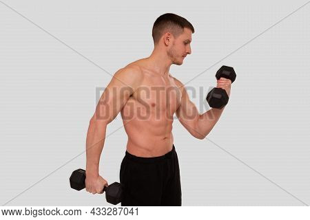 Man Topless Pumping Biceps With Dumbbell. Sprotsman Doing Traning On Biceps Muscles. Gym, Lifting Sp