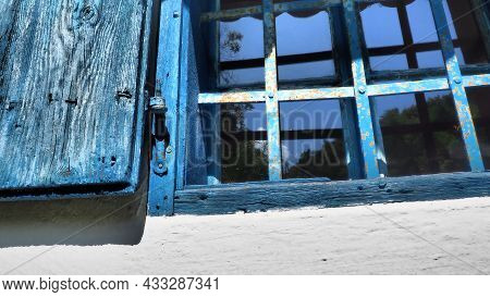 The Old Wooden Shutters Are Open. The Wooden Window Frames And Shutters Are Painted Blue. White Conc
