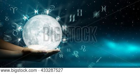 Astrological Zodiac Signs Over The Moon In Hand. Knowledge Of The Stars In The Sky. The Power Of The