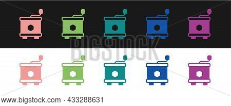 Set Honey Extractor Icon Isolated On Black And White Background. Mechanical Device For Honey Extract