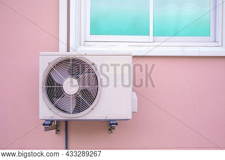 Air Compressor, Close-up External Split Wall Type Of Outdoor Home Air Conditioner Unit Installed On