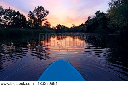 sup board on lake water surface in evening time
