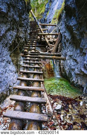 wooden steps in gorge in mountain forest. Take it in Slovakia mountains
