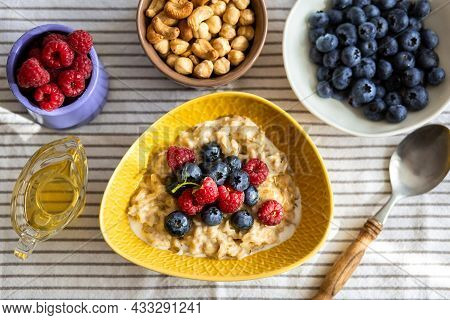 Oatmeal with berries and honey for breakfast.Beautiful healthy breakfast.Proper nutrition of the stu