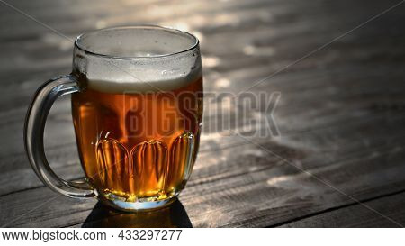 Refreshing Fresh Draft Beer In A Dewy Glass. Good And Honest Czech Quality Beer On A Wooden Table Ba
