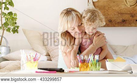 Smiling Mom Hugs Her Daughter Child, Preschool Learning Activities At Home, Concept Of Healthy Growi