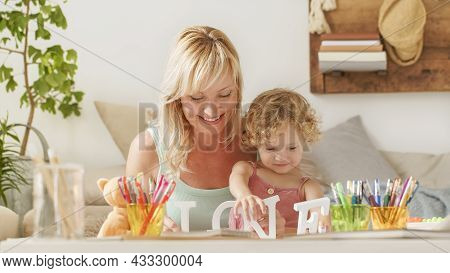 Smiling Mother Smiles At Curly Haired Blonde Daughter Child, Preschool Learning Activity At Home, Co