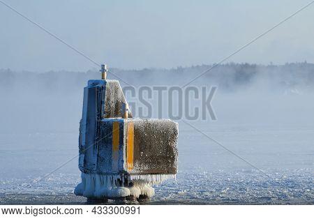 Ice Covered Mooring Pollard Or Docking Pillar By The Baltic Sea In Helsinki, Finland.