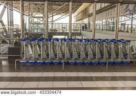 Close Up View Of Baggage Carts At Airport Parking Place. Greece. Thessaloniki. 09.15.2021.