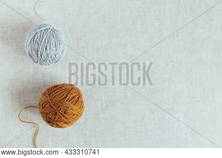 Cozy Balls Of Yarn For Knitting. Background For Handmade And Slow Homelife. Place For Text.