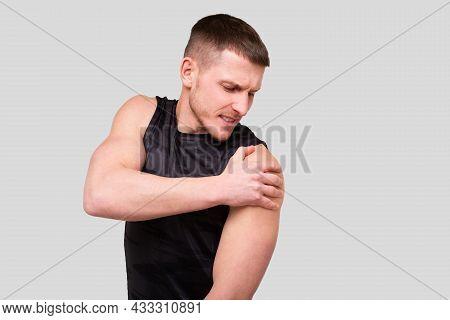 Sport Man Holding Shoulder. Man Having Injury. Sport Man Shoulder Injury