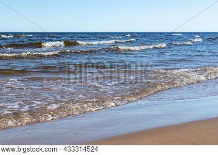 Waves Reaching To Coast At Ragakapa Beach In Jurmala, Latvia. Shoreline Yellow Sandy Shoreline Where