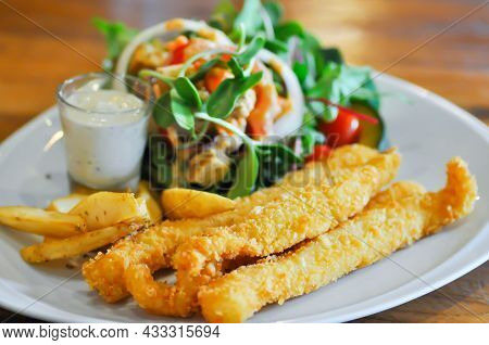 Fish And Chip Or Fried Fish With French Fries And Salad