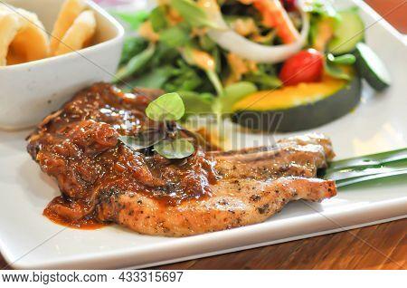 Grilled Pork , Pork Steak Or Pork Chop And Salad