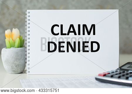 Notepad With The Text Claim Denied On The Table. Finance And Economics Concept.