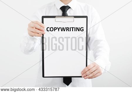 Businessman Holding A White Sheet Of Paper With The Inscription On White Background: Copywriting