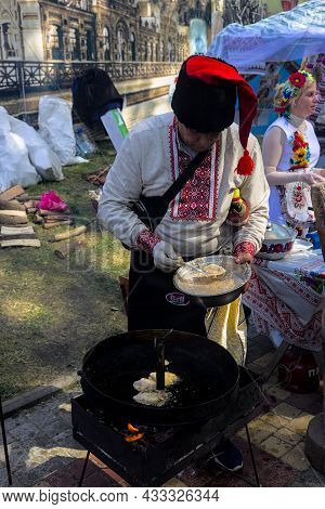 Korosten' Ukraine - September 04 2021: Festival Of Potato Pancakes In The City Park. A Colorful Man