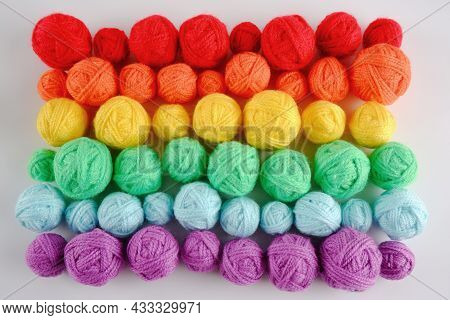 Colorful Background Of Multi-colored Yarn For Knitting, Crocheting.many Balls Of Yarn Of Rainbow Col